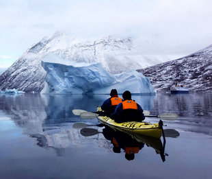 Kayaking past icebergs Antarctica