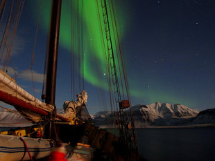 Sailing Boat under Northern Lights in Norway, Jan Belgers