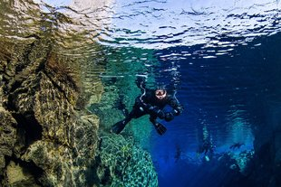 snorkelers-swimming-beautiful-colors-silfra-iceland-anders-nyberg-1800x1200.jpg