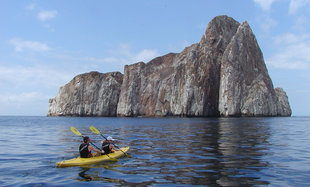 Galapagos Sea Kayaking with Kicker Rock in background off San Cristobal Island