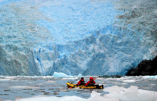 Kayaking by glacier front